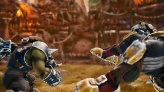 A blood bowl black orc punching an ogre.