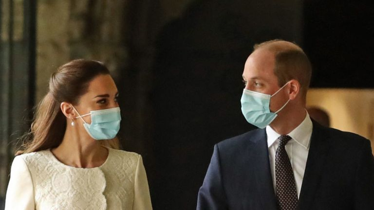 Britain's Prince William, Duke of Cambridge and Britain's Catherine, Duchess of Cambridge arrive for a visit to the coronavirus vaccination centre at Westminster Abbey, central London on March 23, 2021, to pay tribute to the efforts of those involved in the Covid-19 vaccine rollout. (Photo by Aaron Chown / POOL / AFP) (Photo by AARON CHOWN/POOL/AFP via Getty Images)