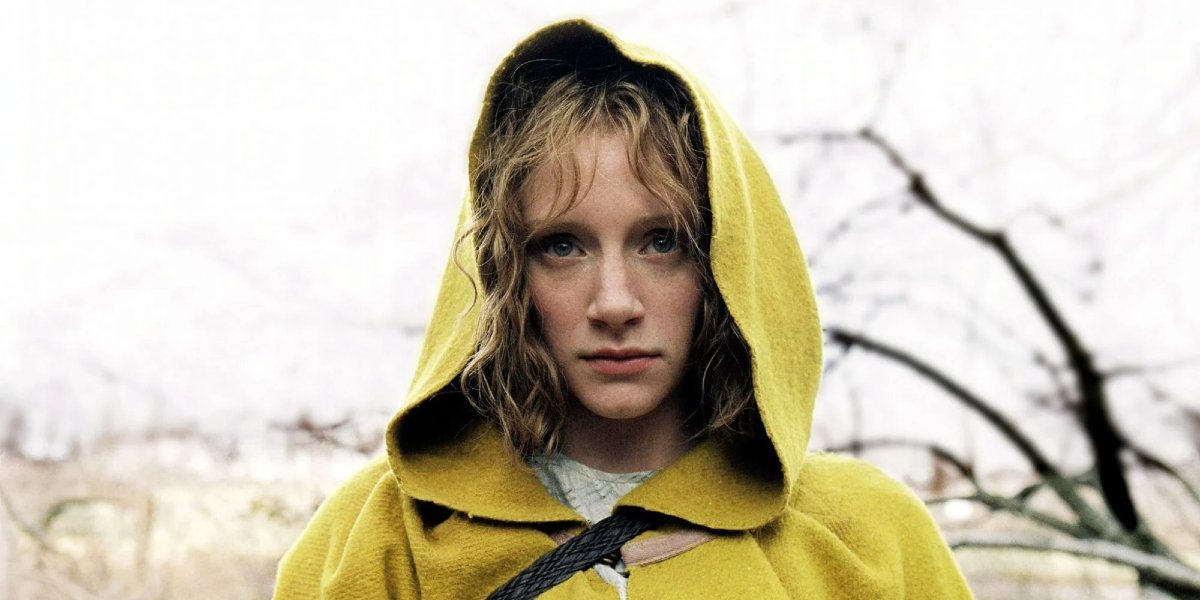 The Village Ivy stands determined in her yellow cloak