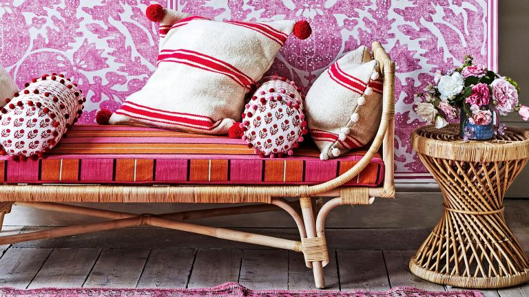 Bohemian bedroom ideas with pink wall and rattan bed