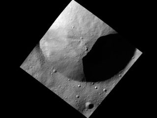 This image, one of the first obtained by NASA's Dawn spacecraft in its low altitude mapping orbit, shows part of the rim of a fresh crater on the giant asteroid Vesta.