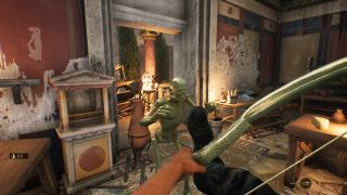 The player is attacked by a skeletal gold statue