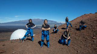 Selene II crew above the HI-SEAS habitat after successfully finishing their analog moon mission.