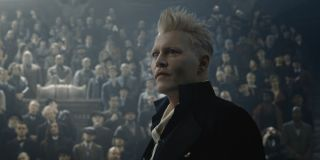 Fantastic Beasts and the Crimes of Grindelwald Johnny Depp stands in front of his audience