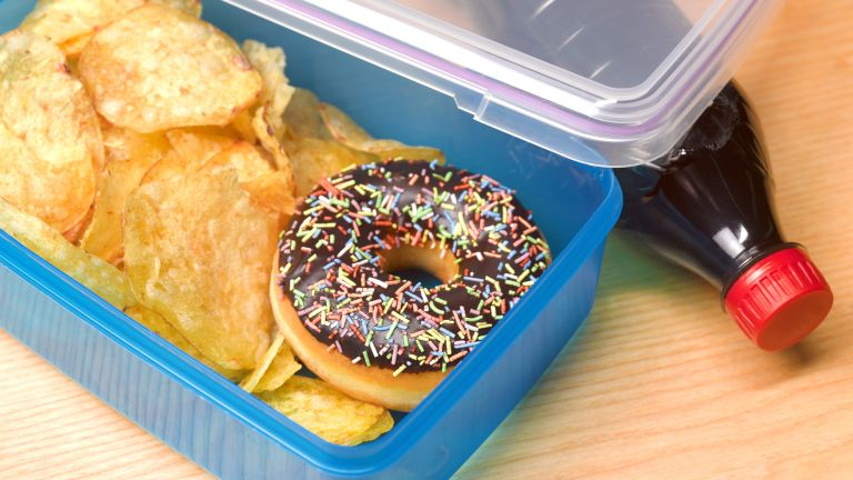Lunch box filled with chips and a doughnut