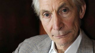 Charlie Watts poses art the The Hospital Club in London in 2012