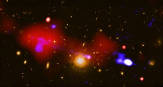 This composite image combines data from NASA's Chandra X-ray Observatory and the NSF's Karl Jansky Very Large Array (VLA). Chandra observed powerful X-rays (red) produced by hot gas circling around a black hole at the center of a galaxy located 9.9 billion light-years from Earth. The VLA was used to detect radio-wave emissions (blue) emitted by the jet of high-energy particles streaming from the black hole.