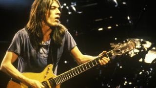AC/DC's Malcolm Young performing live onstage, playing Gretsch 6131 Jet Firebird guitar
