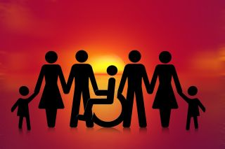 Illustration: Family rendered in silhouette against sunrise includes person in wheelchair