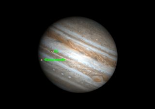 Jupiter's moons Io and Ganymede will cast shadows on the planet as viewed from North America on Jan. 24, 2011.