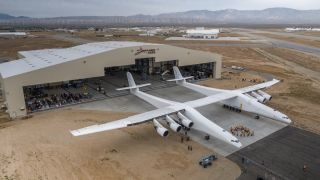 The Stratolaunch aircraft, which weighs about 500,000 pounds (227,000 kilograms) moved out of the hangar to conduct aircraft fueling tests on May 31, 2017.
