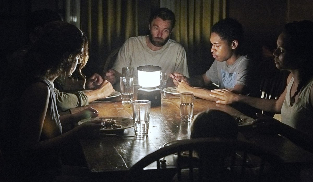 It Comes At Night the family eating by lantern light