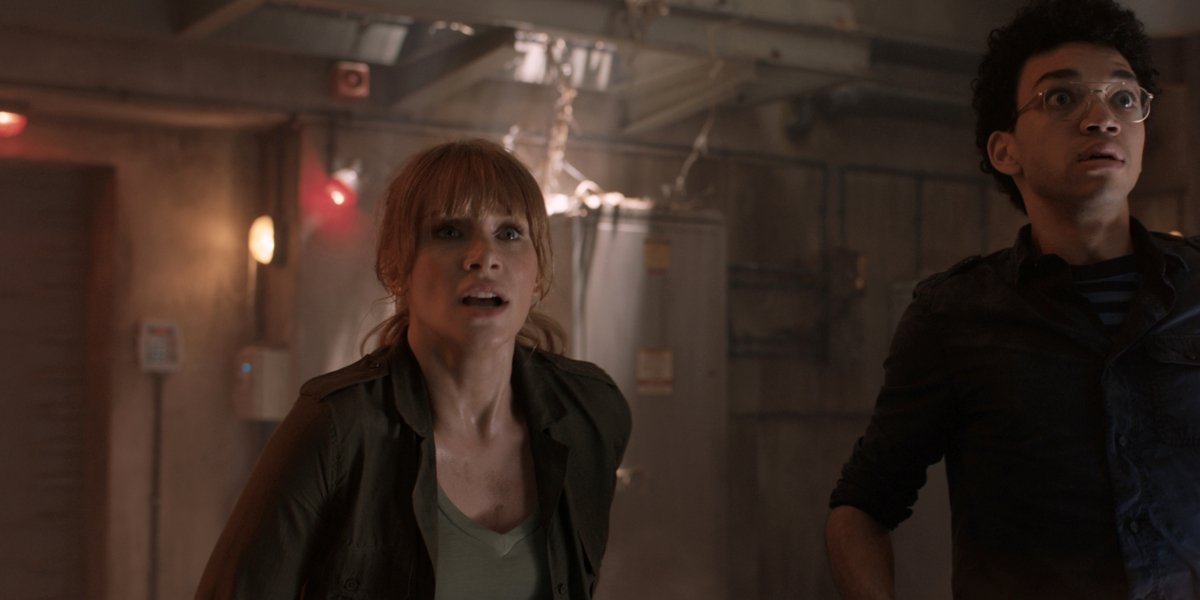 Bryce Dallas Howard and Justice Smith staring down something dangerous in Jurassic World Fallen Kingdom.