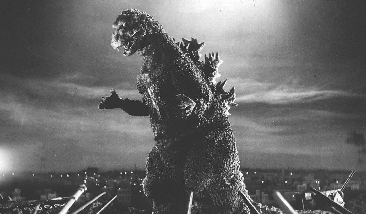 Godzilla rampaging over a small city