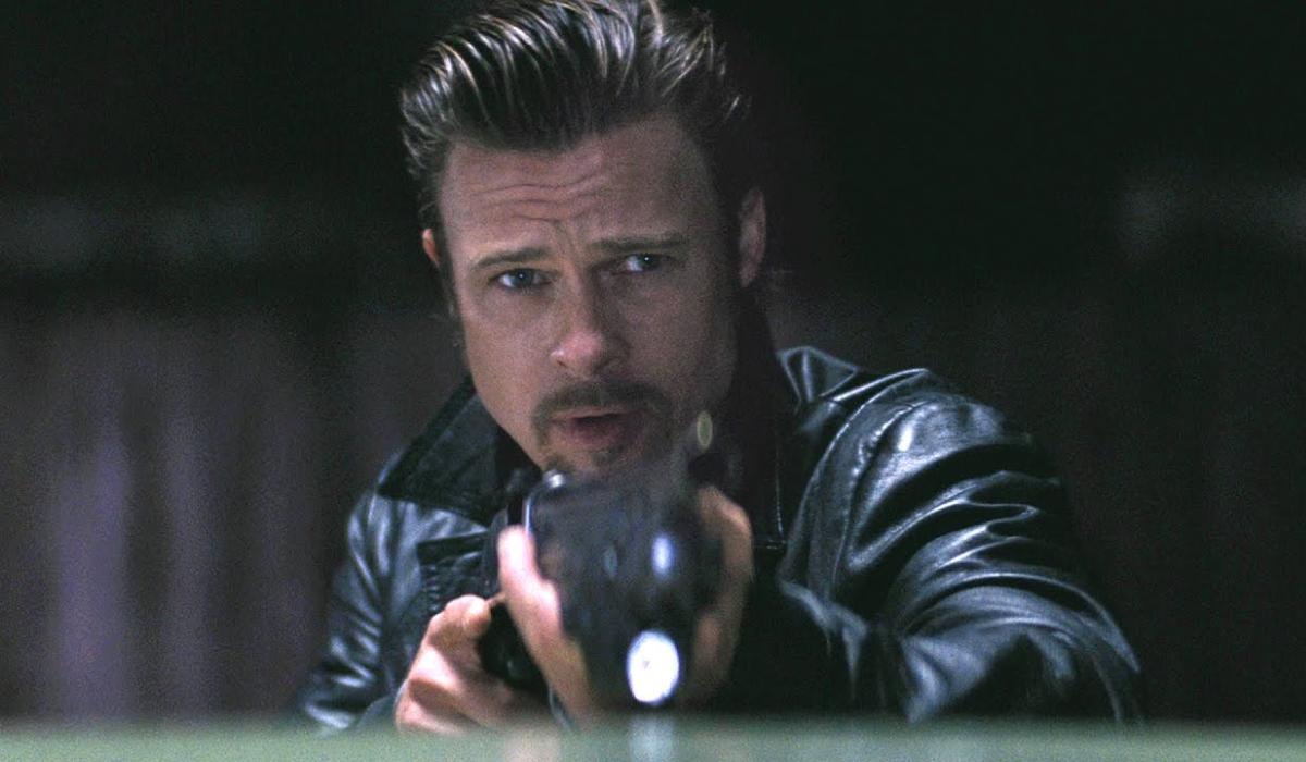 Brad Pitt aims his shotgun at the camera in Killing Them Softly.
