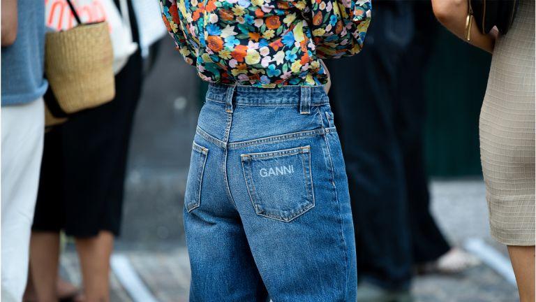 COPENHAGEN, DENMARK - AUGUST 10: Guest outside Ganni wearing Ganni jeans during Copenhagen fashion week SS21 on August 10, 2020 in Copenhagen, Denmark. (Photo by Raimonda Kulikauskiene/Getty Images)