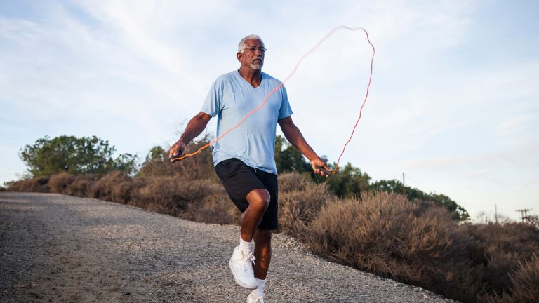 Senior man jumping rope, one of the best exercises for weight loss