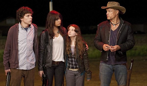 Zombieland Jesse Eisenberg Emma Stone Abigail Breslin and Woody Harrelson stand outside in the night