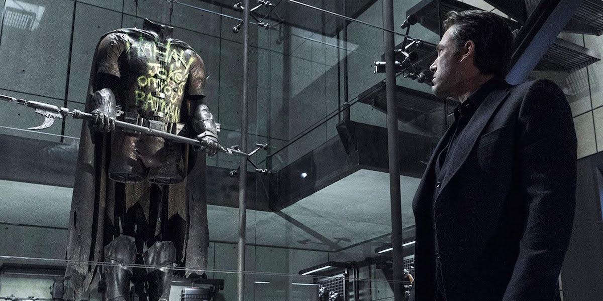 Bruce Wayne looking at Robin suit in Batman v Superman