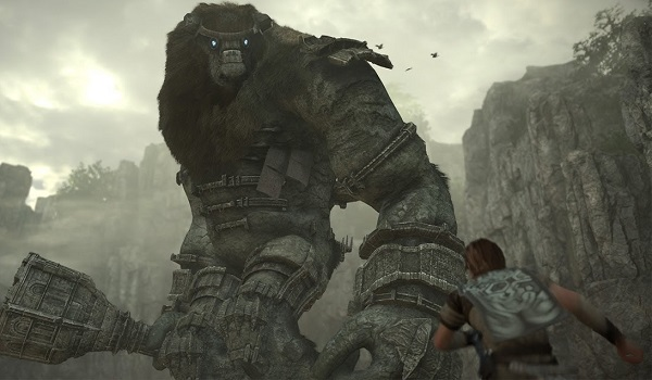 A colossus towers over Wander in Shadow of the Colossus