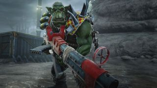 An orc looks menacingly into the camera with a giant gun
