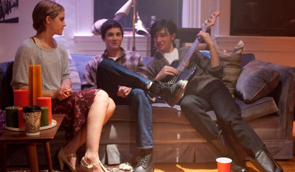 The Perks of Being A Wallflower Emma Watson sits with Logan Lerman and Ezra Miller at a party