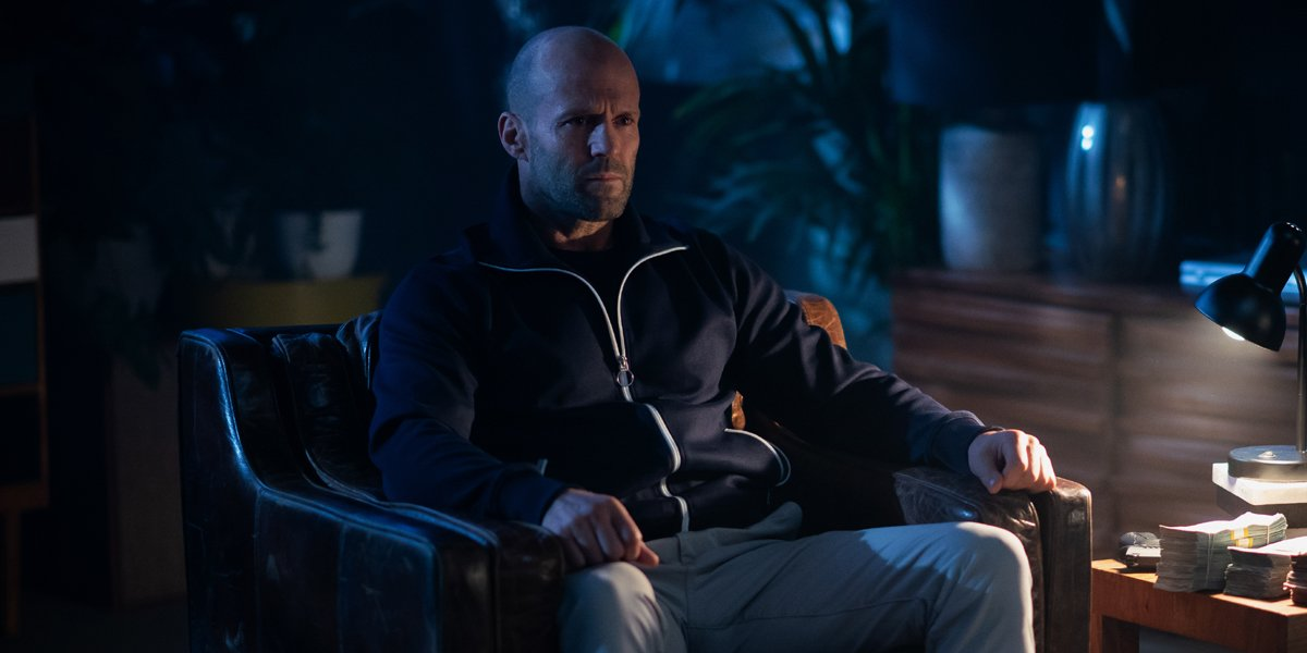 Jason Statham sits in a chair in Wrath of Man