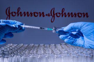 Johnson & Johnson vaccine vials and syringe.