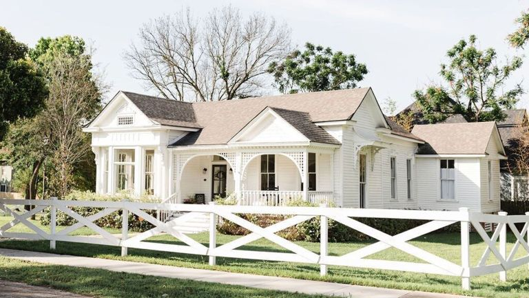 exterior of large white house from fixer upper