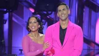 cheryl burke and cody rigsby dressed in all pink on dancing with the stars season 31 premiere