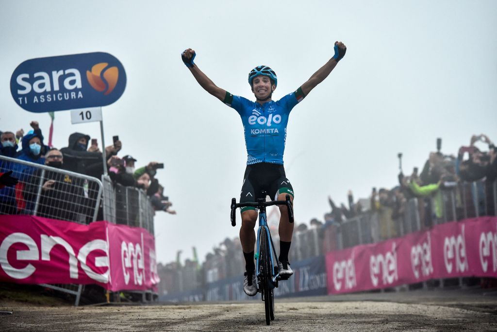 Team EOLO Kometa Cycling Team rider Italys Lorenzo Fortunato celebrates as he crosses the finish line to win the 14th stage of the Giro dItalia 2021 cycling race 205km between Citadella and Monte Zoncolan on May 22 2021 Photo by Tommaso Pelagalli AFP Photo by TOMMASO PELAGALLIAFP via Getty Images