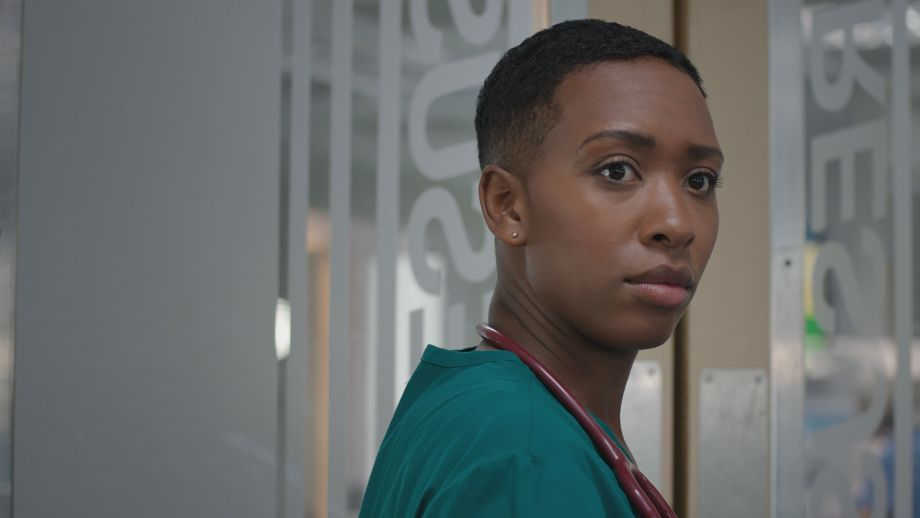 Archie Hudson looks on shocked when a familiar face returns to the ED in Casualty