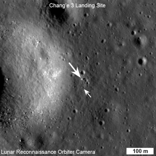 "China's Chang'e 3 moon rover (large arrow) and rover (small arrow) are shown in this view from the LROC NAC instrument of NASA's Lunar Reconnaissance Orbiter just before lunar sunset on their first ""day."" Image released Dec. 30, 2013."
