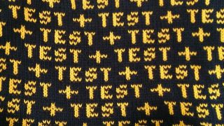 The word 'test' knitted on a length of wool