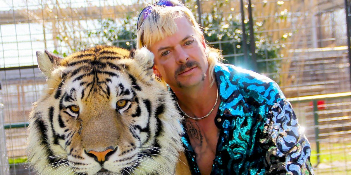 Joe Exotic posing with a tiger The Masked Singer