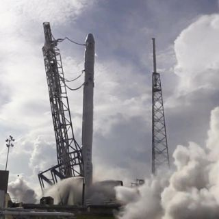 SpaceX checks its next Falcon 9 rocket to fly in a static engine test ahead of a planned April 13, 2015 launch to send an unmanned Dragon cargo ship to the International Space Station, then attempt a reusable rocket landing on an ocean platform.