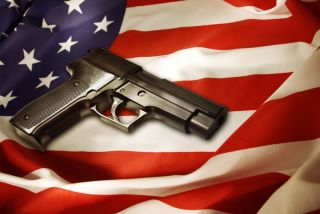 Handgun lying on American flag.