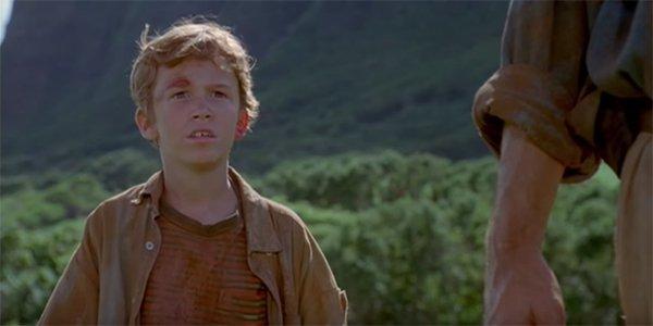 Joseph Mazzello's Tim watching the herd approaching in Jurassic Park