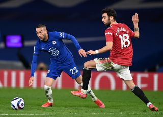 Bruno Fernandes challenges Hakim Ziyech for the ball