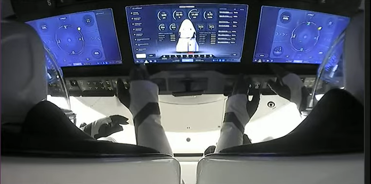 A view over the shoulders of Jared Isaacman on the left and Sian Proctor on the right aboard the Inspiration4 SpaceX Crew Dragon on Sept. 15, 2021.