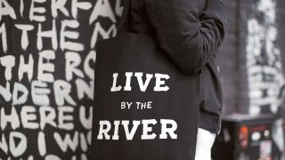 Camden market tote bag reading 'Live by the river'