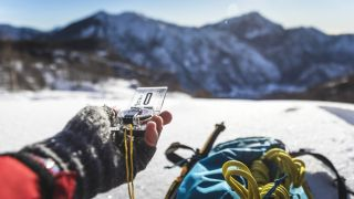 compass bubbles: mountaineer looking at map and compass