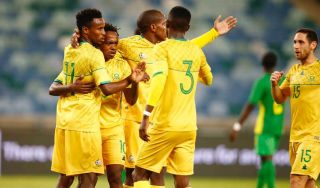Bafana Bafana's Percy Tau celebrates his goal with temmates