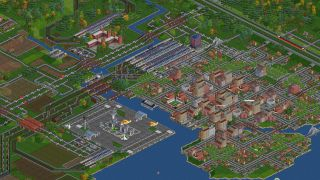 An image from transport game OpenTTD of trains and a village