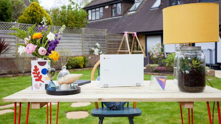 outdoor desk with chair, laptop and accessories in a garden - jeyes fluid