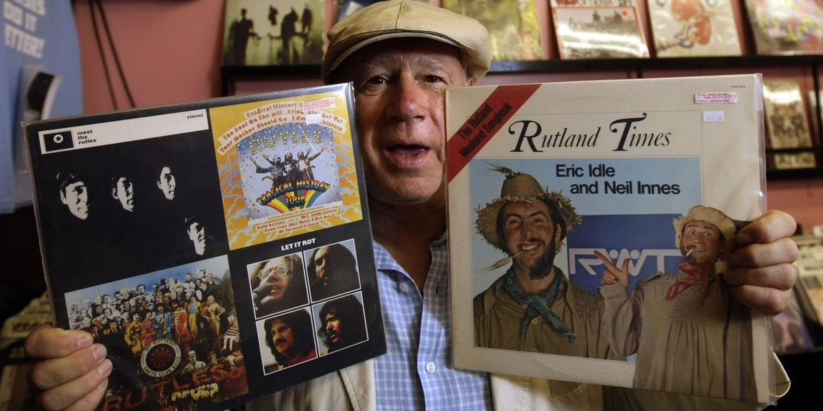 Neil Innes with a Beatles record and a Rutland record in hand