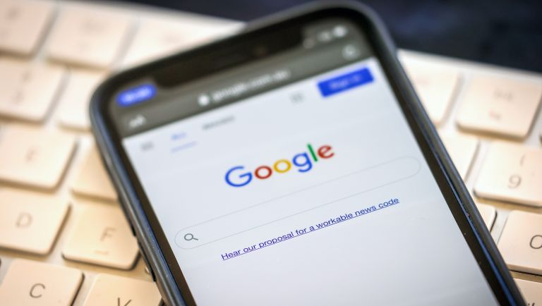 A link to Google's proposal to a workable news code on the company's homepage, arranged on an iPhone in Sydney, Australia, on Friday, Jan. 22, 2021.