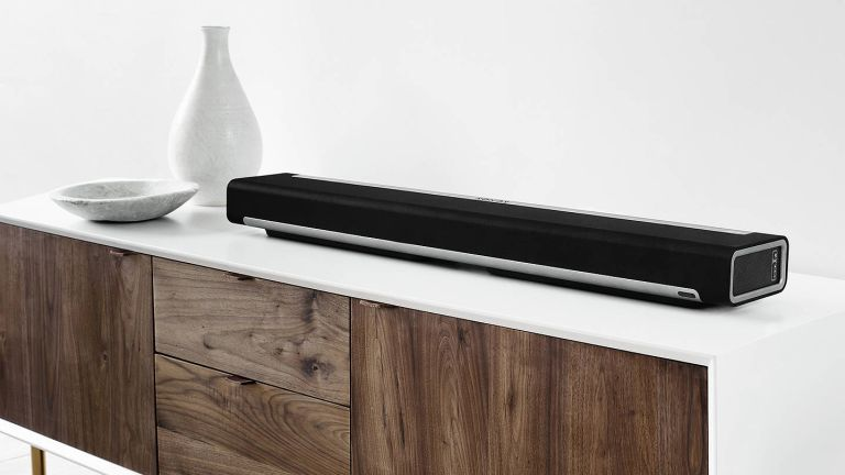 the best soundbar: soundbar positioned on sideboard styled with white accessories