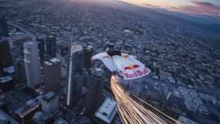 Sparks Fly as Skydivers Glide Past a Dazzling Supermoon in Epic Red Bull Stunt!