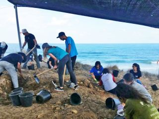 Local youth participate in excavations in Ashkelon, Israel. The team uncovered Ottoman-era buildings, including a lookout tower and a fisherman's house.